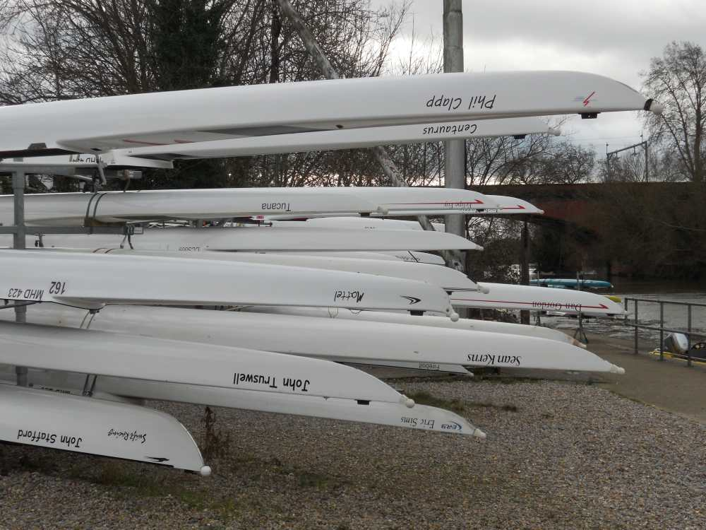 Rowing boats at rest besides the River Thames
